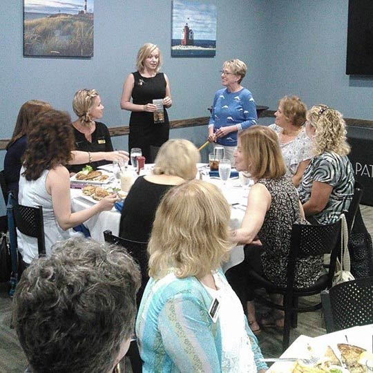 women in leadership members attending an event involving a guest speaker